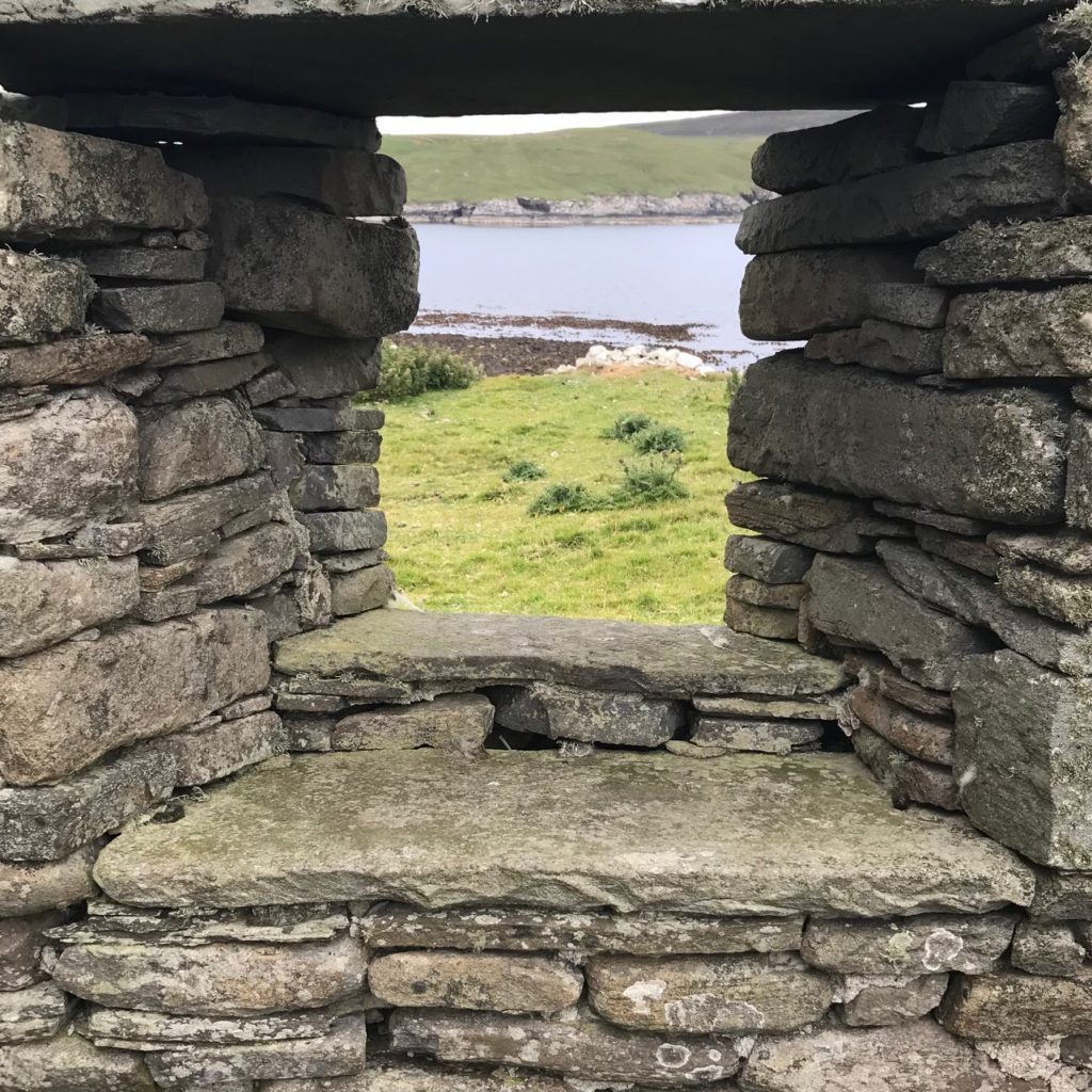 The view through the window of an abandoned crofthouse on Bressay Island in Shetland.