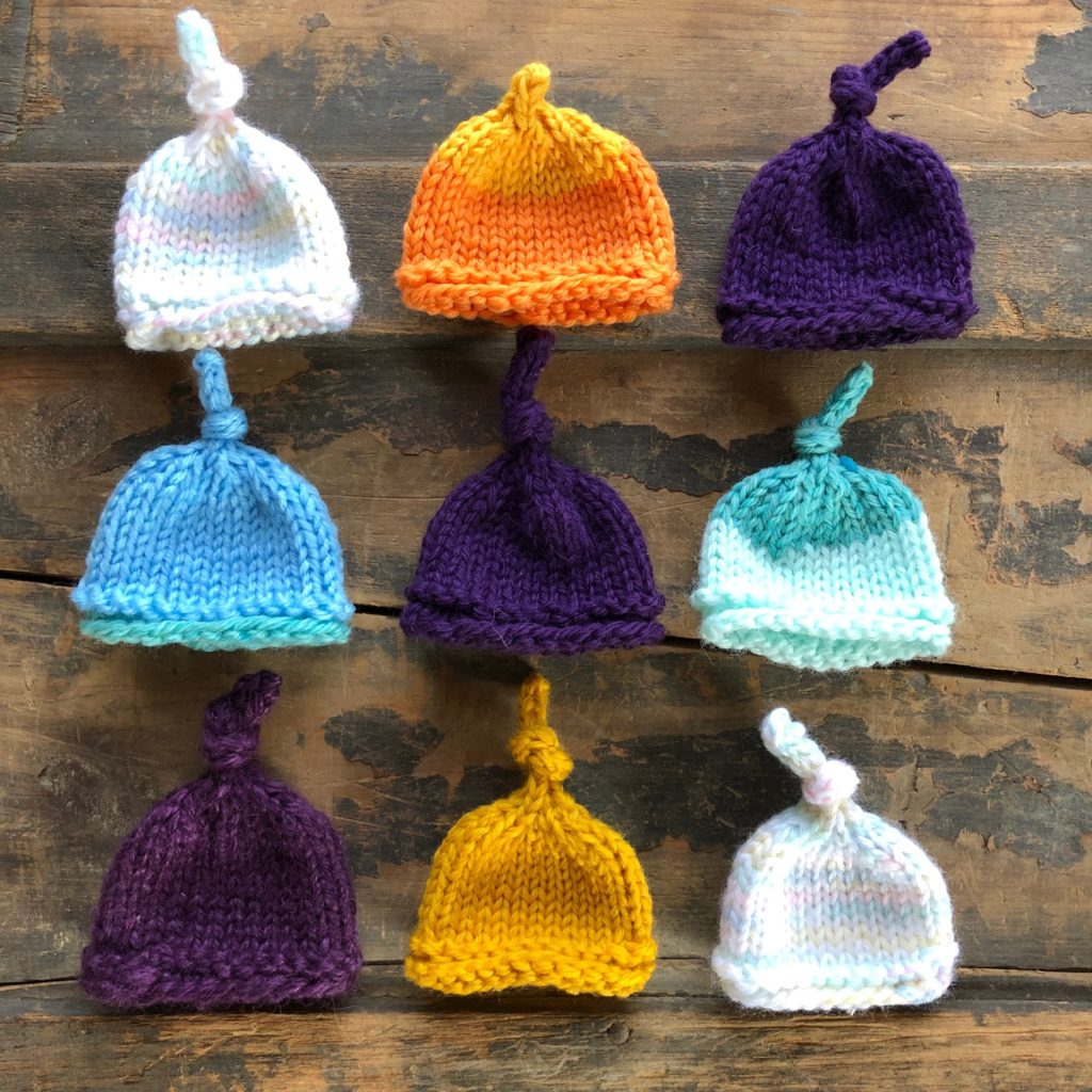 9 mini hats laid out in an array